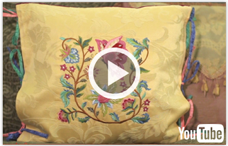 Free video with instructions on how to create an embroidered tie-on pillow sham.