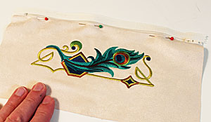 Free project instructions to make an embroidered wristlet purse.