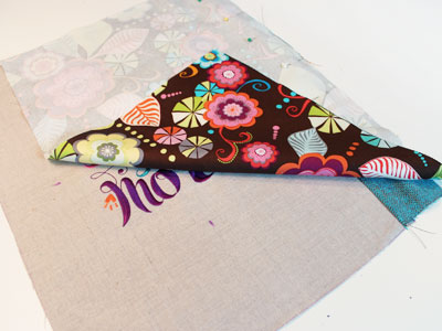 Free project instructions to embroider a pretty print pillow.