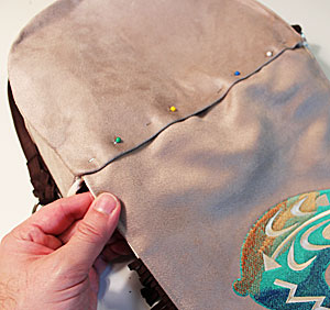 Free project instructions to make an embroidered western-style fringed handbag.