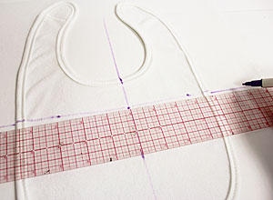 Free project instructions to make an embroidered baby bib.