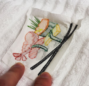 Tips and tricks for minimizing stabilizer on the back of machine embroidery designs.