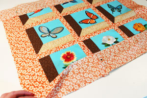 Free project instructions to make a quilted attic windows wall hanging.