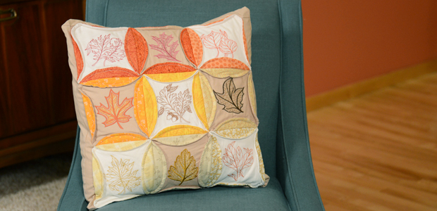 Free project instructions to embroider a cathedral window pillow.