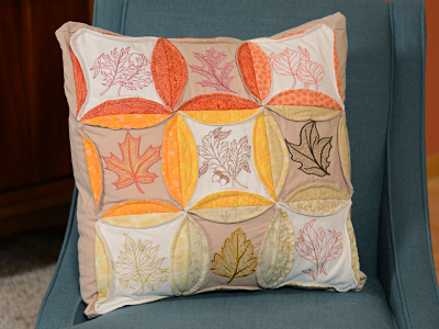 Free project instructions to make a quilted cathedral window pillow.