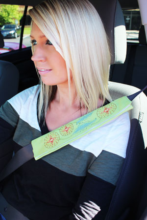 Free project instructions to make an embroidered seat belt cover.