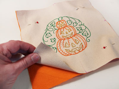 Free project instructions to create a rag quilt trick-or-treat bag.