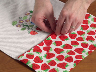 Free project instructions to embroider a let's dish kitchen towel.
