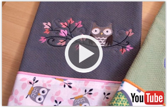 Free video with instructions on how to embroider a let's dish kitchen towel.