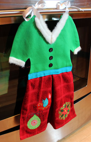 Free project instructions to make an embroidered Mrs. Claus Towel Topper