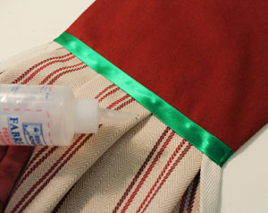 Free project instructions to make an embroidered Gingerbread Towel Topper