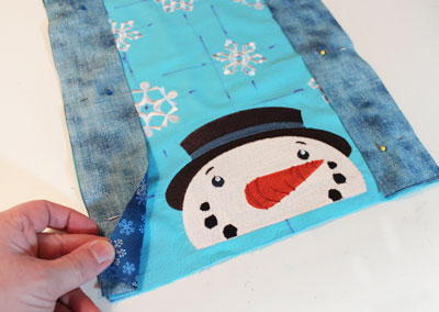 Free project instructions to embroider a let it snow wall hanging.