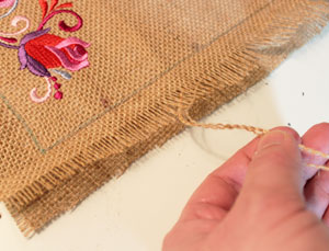 Free project instructions to make embroidered table toppers and placemats.