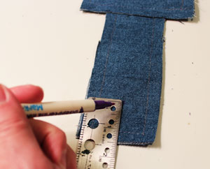 Free project instructions for an embroidered fringed denim tote.