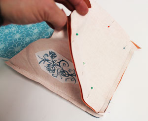 Free project instructions for an embroidered tablet stand.