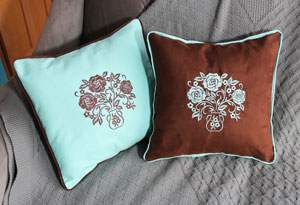 Free project instructions to make a set of embroidered pillows.
