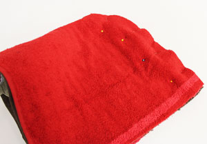 Free project instructions to make an embroidered bath towel hood