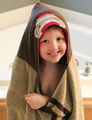 Free project instructions to make an embroidered hooded bath towel