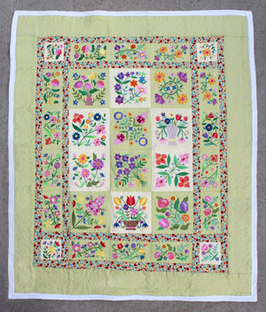 Free project instructions for an embroidered lap quilt