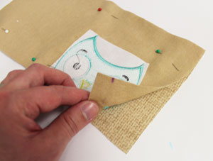 Free project instructions to make an embroidered mug rug