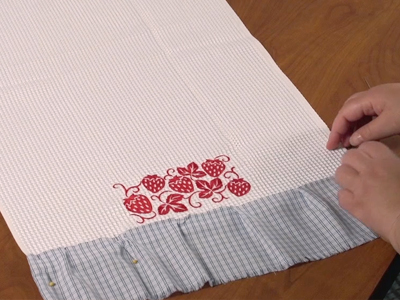 Free project instructions to dress up a dish towel.