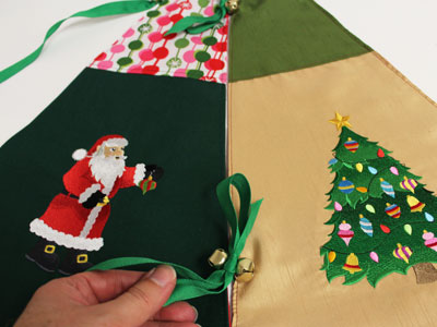 Free project instructions to embroider a jingle all the way Christmas tree skirt.