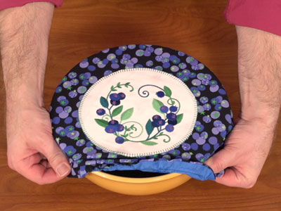 Free project instructions to embroider a fabric bowl cover.