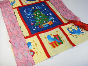 Free project instructions to make an embroidered Christmas wall hanging
