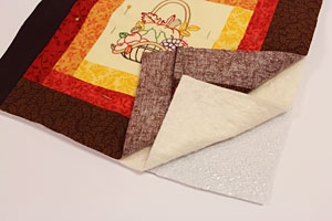 Free project instructions to make an embroidered burlap table runner.