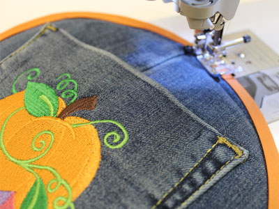 Free project instructions to create a denim pocket potholder.