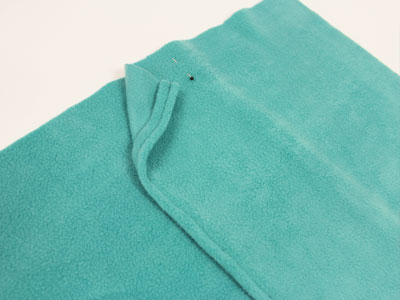 Free project instructions to embroider a fleece pillow.