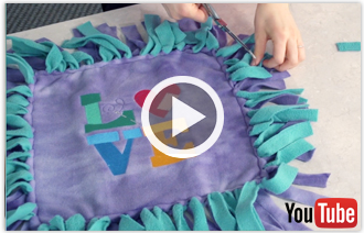 Free video featuring with instructions for making a Squeeze Me! Fleece Pillow.