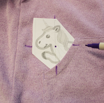 Free project instructions to embroider an applique peek-a-book hoodie.
