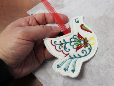 Free project instructions to make in-the-hoop stuffed ornaments.
