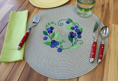 Free project instructions to embroider on straw placemats.