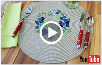 Free video with instructions on how to embroider on straw placemats.