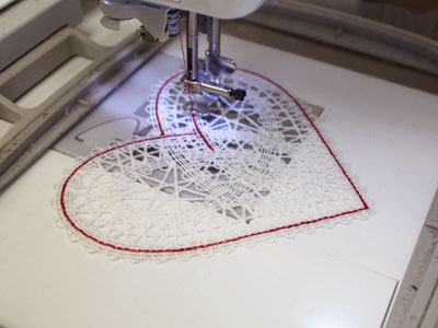 Free project instructions on how to embroider a battenburg lace heart doily.