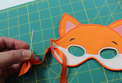 Free project instructions to embroider In-the-Hoop Masks.