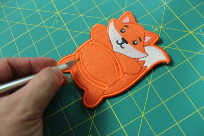 Free project instructions to embroider In-the-Hoop Napkin Holders.