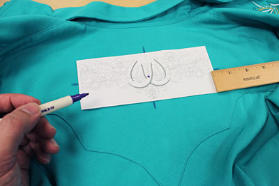 Free project instructions to embroider a wranglin' western shirt.