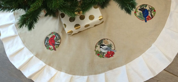 Free project instructions to embroider a cozy Christmas tree skirt.