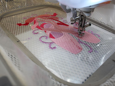 Free project instructions to embroider a fancy footwork shoe bag.