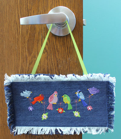 Free project instructions to embroider a denim doorhanger.