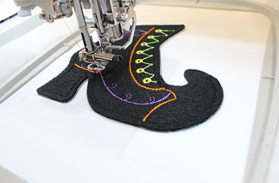 Free project instructions to embroider in-the-hoop bewitching boots.