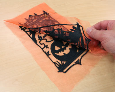 Free project instructions to embroider a seasonal silhouettes luminary.