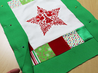 Free project instructions to make a Christmas block pillow.