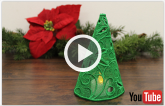 Free video with instructions on how to embroider freestanding lace Christmas trees.
