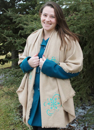 Free project instructions to make an embroidered blanket scarf.
