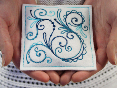 Free project instructions for embroidering In-the-hoop hand warmers.