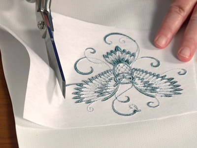 Free project instructions to embroider oilcloth coasters.